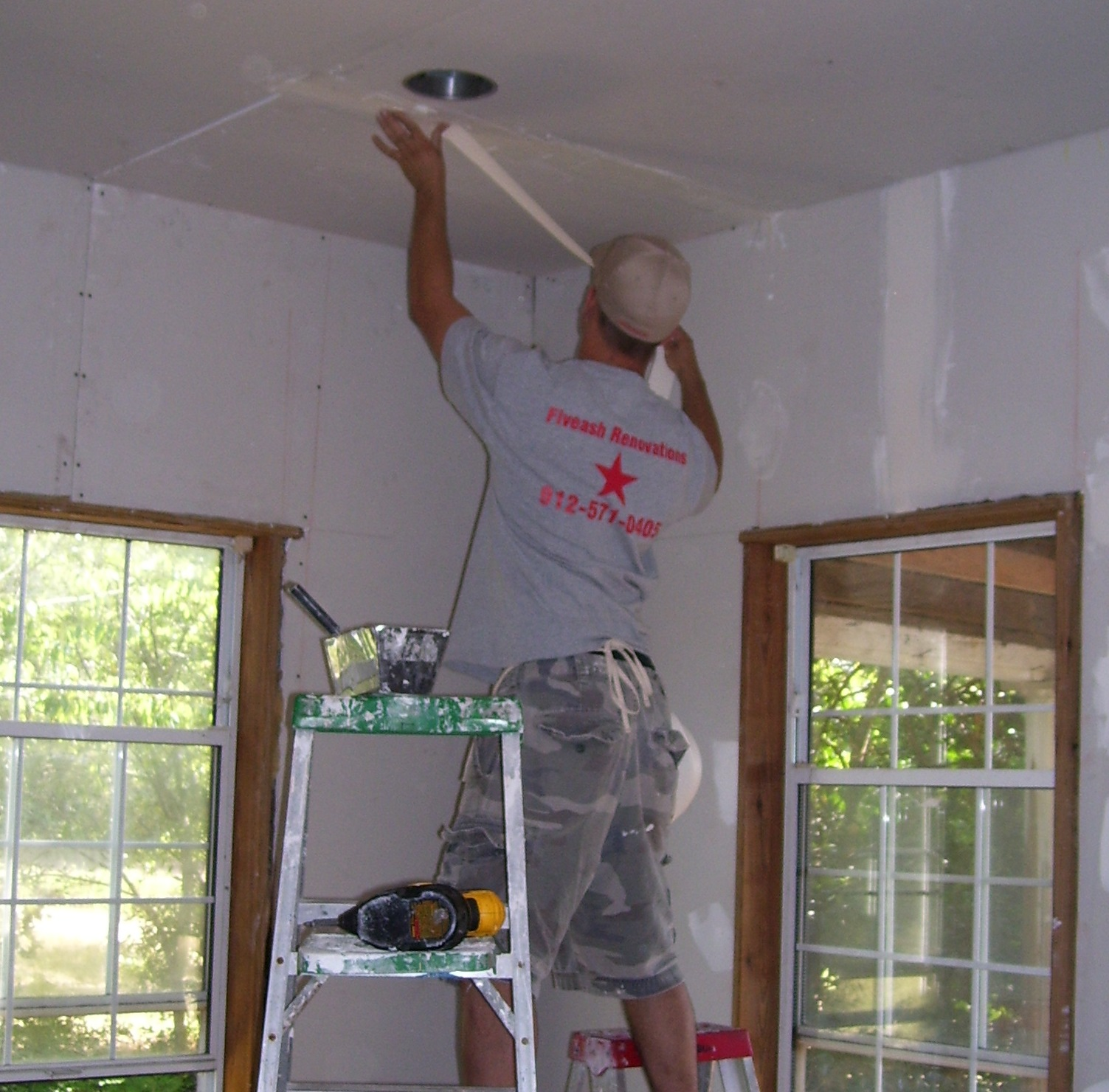 Owner/Operator Taping drywall in a Home Renovation/Remodel
